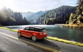 orange range rover land rover range rover sport orange lake forest side view car road