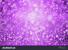 abstract dark purple glitter sparkle confetti stock photo