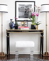 console table skinny floor lamps flanking the console instead of