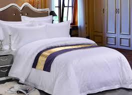 pure white sateen otel duvet bedding with purple bed runner