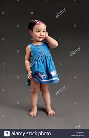 a full length portrait of a tiny adorable 2 year old chinese