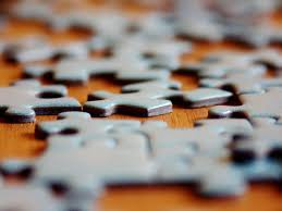 jigsaw puzzle on wooden panel free image peakpx