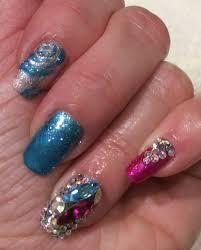 gel nails pointed nails glitter feature nail crystals nail art