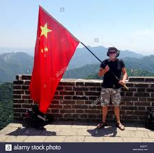 Chineses Flag Person Waving The Chinese Flag On The Great Wall Stock Photo