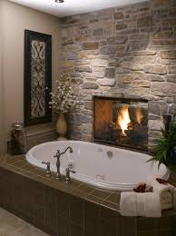 eldorado stone two sided fireplace facing both bedroom and
