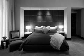 black walls in bedroom black wall panel combined with black bed sheet with pillow between