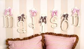 hanging wooden wall letters with pink ribbon and striped wall