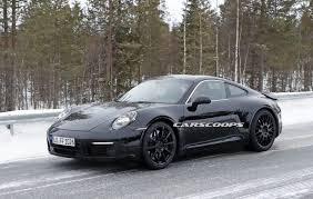 porsche electric hybrid porsche 911 hybrid appears to be moving forward engineers