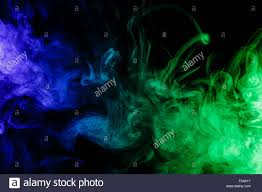 halloween design background abstract art colour blue green smoke hookah on a black background