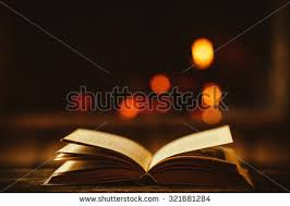 open book by fireplace ornaments stock photo 321681284