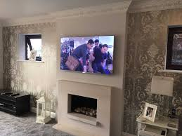 living room what is a console tv marble fireplace mantel shelf