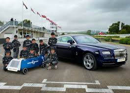roll royce green rolls royce cars celebrates major race success at goodwood