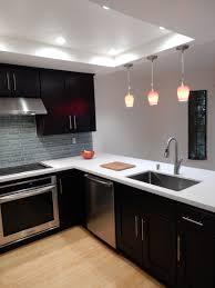 espresso kitchen cabinets with white quartz countertops espresso cabinets white quartz countertops glass back