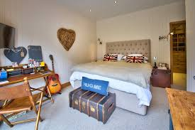 guitar closet bedroom eclectic with white beadboard walls wall