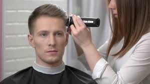 female haircutting videos clipper head hair clipper and comb guy getting haircut close up stock