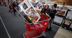 us sales surge as shoppers throng stores on thanksgiving