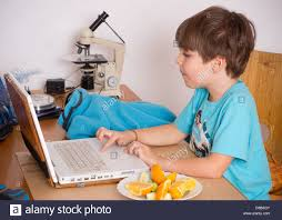 kid kids watching tv television house laptop computer table desk