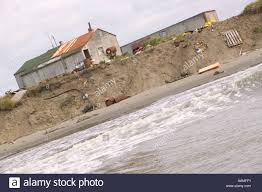 global houses eskimo houses perilously close to the sea following global warming