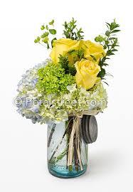 Mason Jar Floral Centerpieces Yellow Roses U0026 Blue Hydrangea In A Mason Jar Petal Street Flower