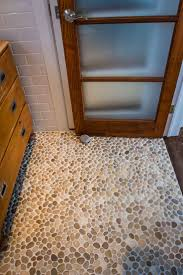 river rock bathroom ideas best 25 river rock floor ideas on pinterest river rock tile