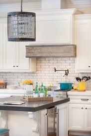 Rustic Kitchen Hoods - a rustic u0026 modern white kitchen by calgary interior designer