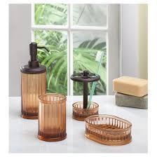 the interdesign bath accessory set features a refillable soap