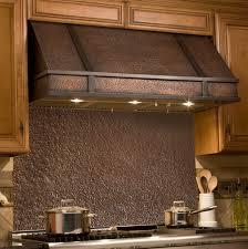 copper range hood backsplash