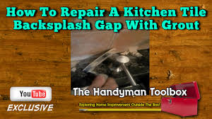 Grout Kitchen Backsplash by How To Repair A Kitchen Tile Backsplash Gap With Grout Youtube