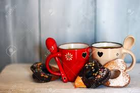 photo of cute coffee cups with heart shaped cookies stock photo