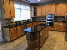what color goes best with maple cabinets honey maple cabinets paint or not to paint