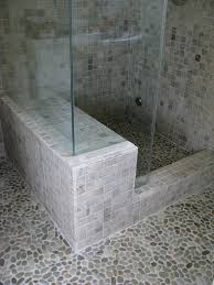 onyx steam shower with golden pebble tile flooring zen paradise