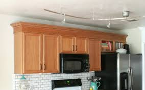 crown molding for kitchen cabinet tops how to put crown molding on top of kitchen cabinets