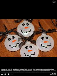 snowmen ornaments would for them to put int the glitter
