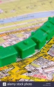 monopoly map a row of monopoly houses on a map stock photo royalty free
