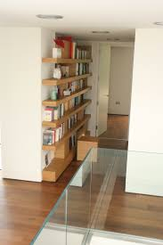 oak floating shelf bookcase with removable cube book ends that can