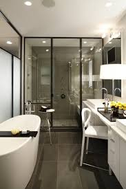 bathroom contemporary bathroom with dark tile flooring plus