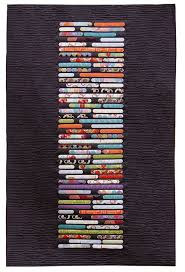 dramatize a focal wall with modern quilt wall hangings annsliee