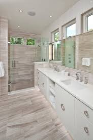 gray wood look tile for the walls and floors crisply contrasts the