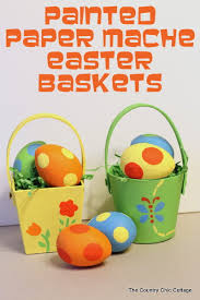 painted easter baskets easter basket painted paper mache basket and eggs decoart inc