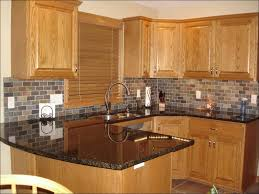 kitchen dark cabinets and light countertops blue engineered
