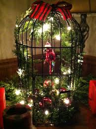 christmas birdcage decoration with glass red parrot on perch