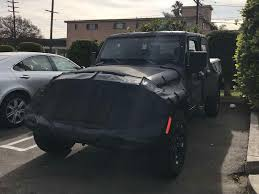 jeep truck spy photos exclusive shots suggest the 2019 jeep wrangler pickup truck will