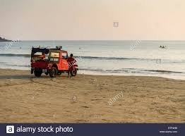 jeep beach live guards with a red jeep are watching palolem beach canacona
