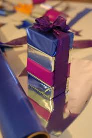 mylar wraps use inexpensive foil or mylar paper to wrap and stack small gifts