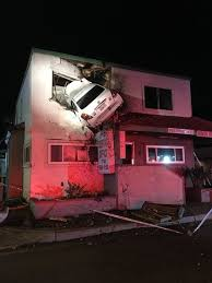 car flies about 60 feet into upper floor of a building in