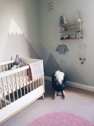 a gender neutral pastel nursery with mountain mural j for jen