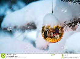 gold christmas tree ornament reflects nativity sce stock photos