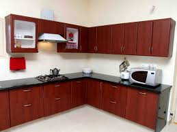 modular cherry ebony wood kitchen cabinet with black marble top