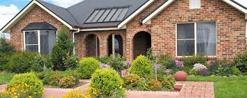 brick wall houses front garden that can be decor with modern