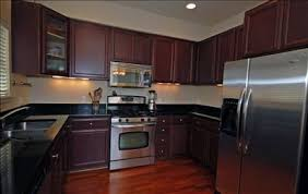 Cherry Wood Kitchen Cabinets With Black Granite Black Cherry Kitchen Cabinets Home Design Plan